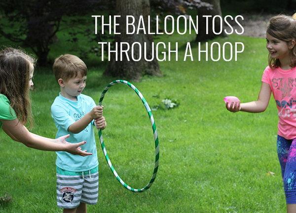 Balloon Through Hoop Water Balloon Game
