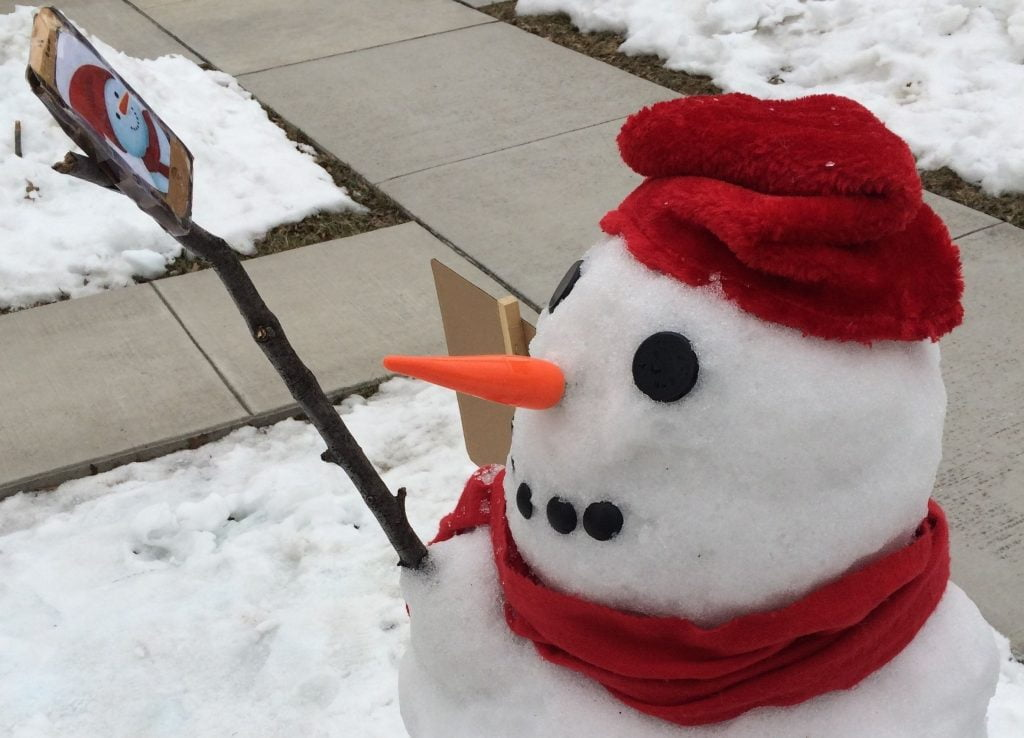 Snowman Uses a Smartphone