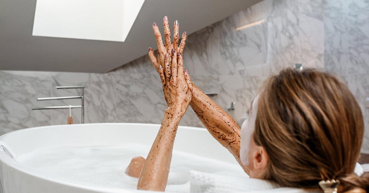 Sensual Woman Scrubbing Arms In Bath