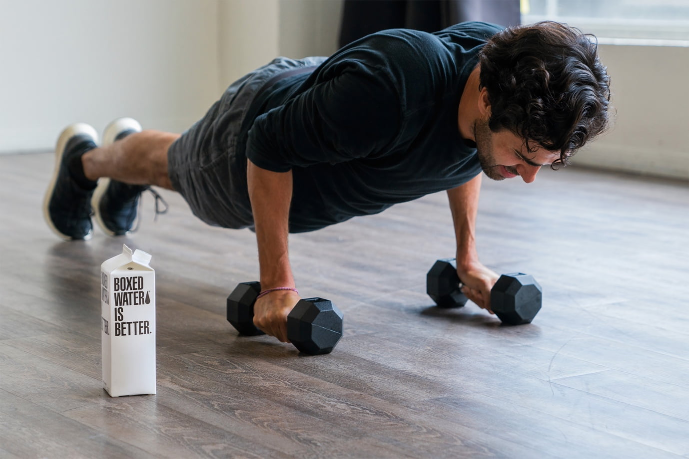 A person doing push ups Description automatically generated with low confidence
