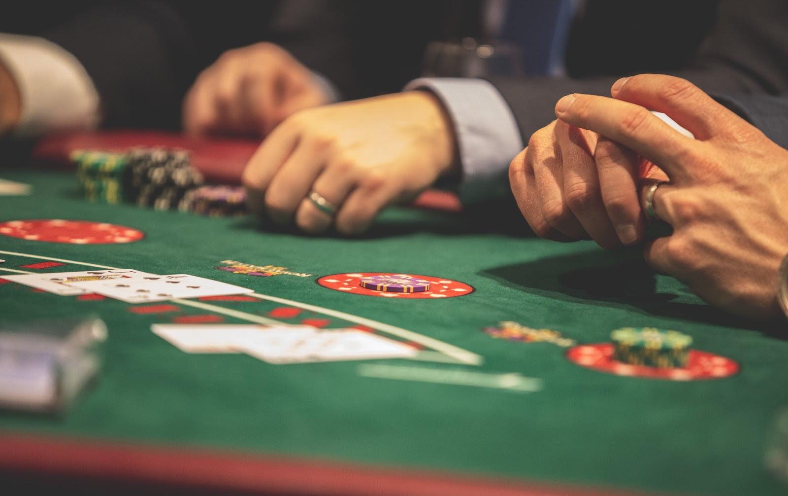 A picture containing room, gambling house, scene, person Description automatically generated