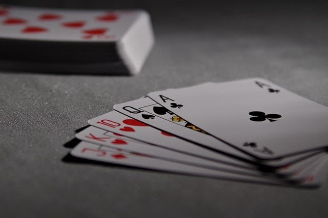 A picture containing text, queen, room, gambling house Description automatically generated