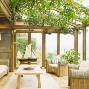 A three seasoned sun-room as the transition of an enclosed patio_Country Living Magazine