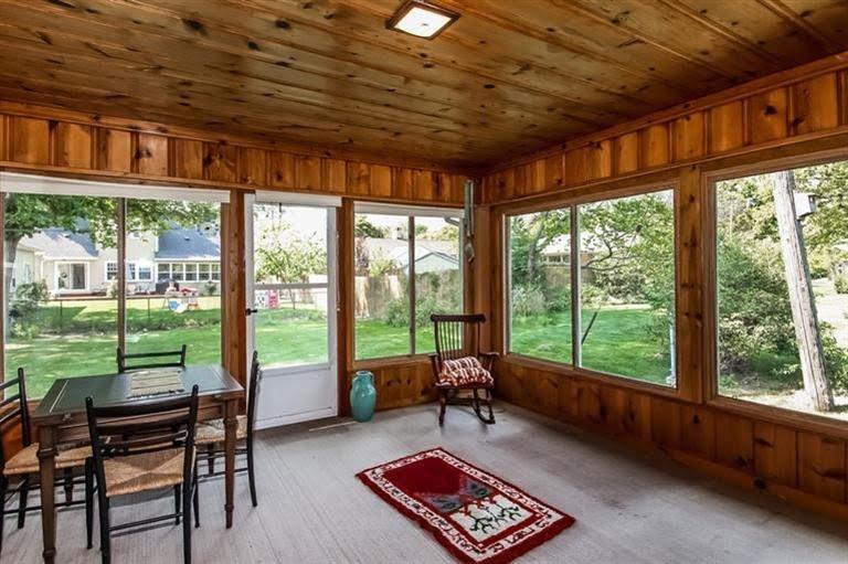 A sun-room design in Knotty pine panelling_Interior design ideas