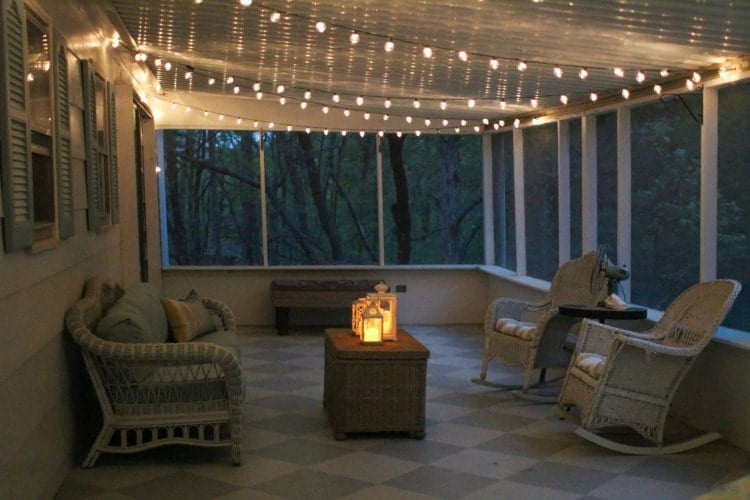 4. An enclosed patio with globe string lights_Lovely