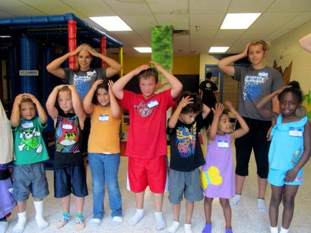 A group of children playing the Simon says