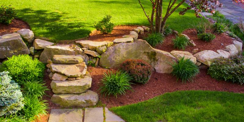Well landscaped rock stairs and rock wall